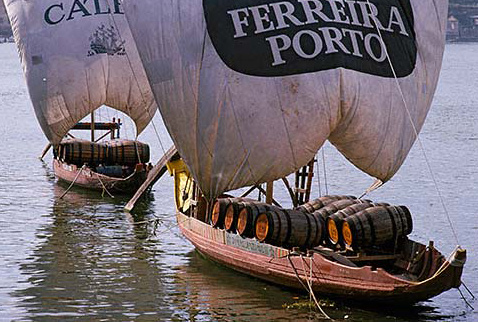 История виноделия Португалии - Barcos Rabelos moored on the Douro at Vila Nova de Gaia, were formerly used for bringing pipes of Port down river from the quintas high up the Douro Valley. Portugal