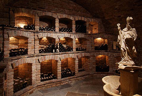 Австрийские вина - Wine library with statue of Saint Urbanus at Weingut Skoff, Gamlitz, Styria, Austria.